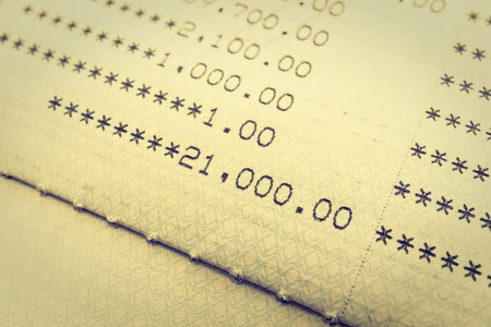paycheck: Selective focus point on Book bank statement account - Vintage Filter