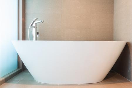 luxury bathroom: White luxury bathtub decoration in bathroom interior