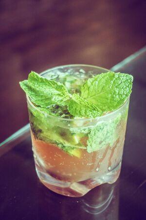 mocktail: Iced Mocktail drink glass in restaurant - Vintage Filter
