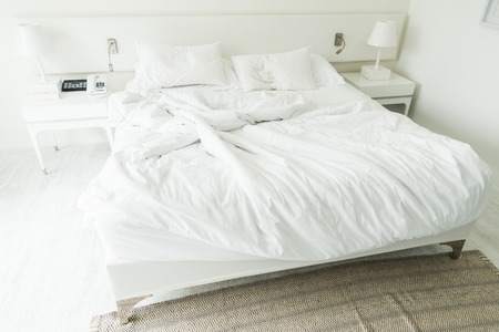 rumpled: White pillow on rumpled bed decoration in bedroom interior