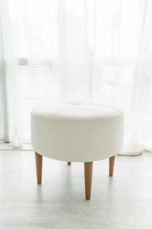 soft furnishing: White stool chair decoration in living room interior Stock Photo
