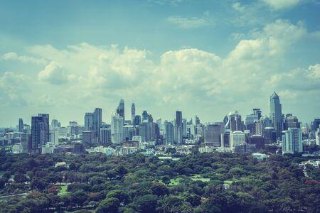 city park skyline: Beautiful Bangkok city skyline around lumphini park in Thailand - Vintage Filter