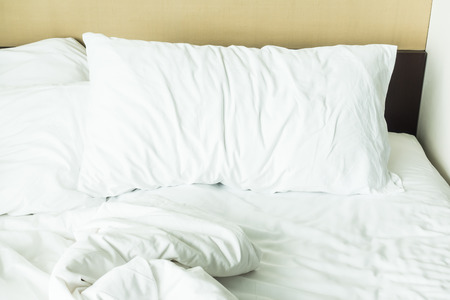 bed sheet: Messy white pillow on  sheet bed decoration in bedroom interior