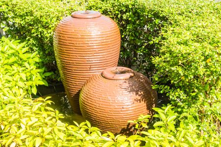asian house plants: Jar Water fountain decoration in the garden