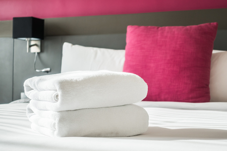 white towel: White towel on bed decoration in bedroom interior