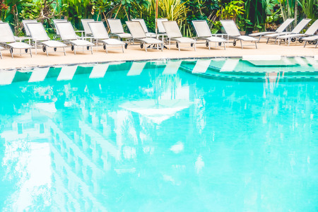 hotel resort: Beautiful outdoor swimming pool with umbrella and chair in hotel resort