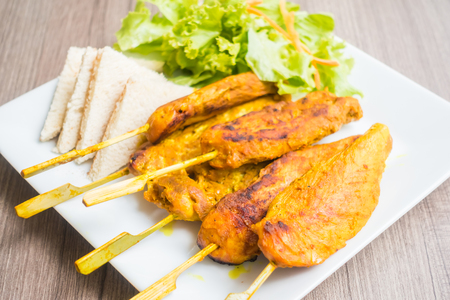 chicken satay: Grilled Chicken satay in white plate
