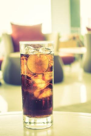 coke: Selective focus point on Coke glass - Vintage Filter Stock Photo