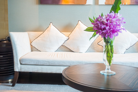 green couch: Vase flower decoration in living room interior with pillow and sofa