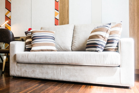 living room sofa: Beautiful luxury pillow on sofa decoration in living room interior Stock Photo