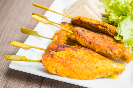Grilled Chicken satay in white plate