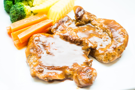 beefsteaks: Grilled pork steak in white plate with vegetable Stock Photo
