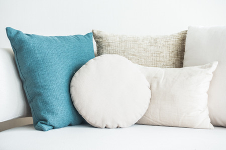 living room sofa: Beautiful pillow on sofa decoration in living room interior Stock Photo