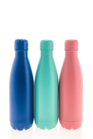 Stainless vacuum flask and thermal bottle isolated on white background