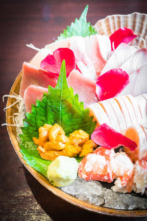 Selective focus point on Sashimi seafood set , Japanese and Healthy food - Dark Processing and Vignetting Effect