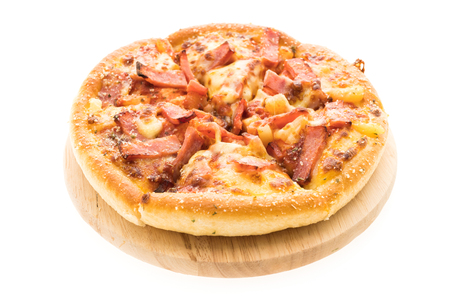 Hawaiian pizza on wooden plate isolated on white background - Junk and unhealthy food style