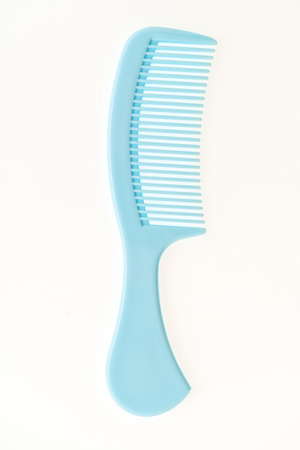 Plastic hair comb isolated on white background