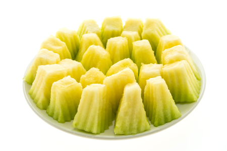 Cantaloupe: Green melon fruit in white plate isolated on white background