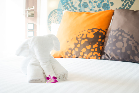 Elephant towel on bed decoration in hotel bedroom interior Stock Photo
