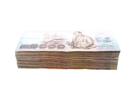 money stack: Thai banknote and cash isolated on white background Stock Photo