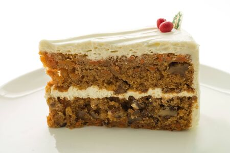 Carrot cake in white plate isolated on white background