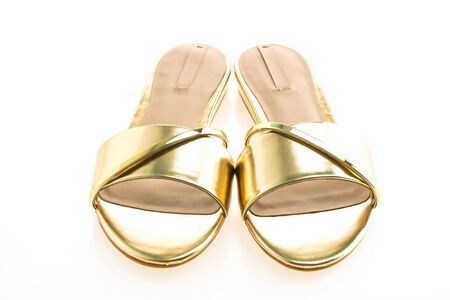 Beautiful gold sandal shoes for woman isolated on white background