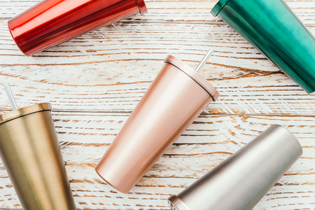 Stainless and tumbler cup on wooden background 写真素材