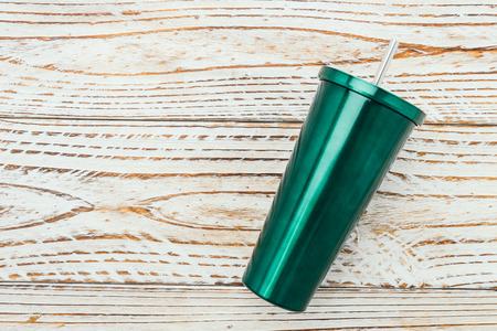 tumbler: Stainless and tumbler cup on wooden background Stock Photo