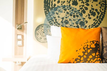 Beautiful pillow on bed decoration in hotel bedroom interior - Filter Effect Stock Photo