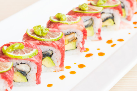 meatloaf: Selective focus point on Beef sushi in white plate - Japanese food style