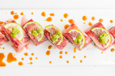 albondigas: Selective focus point on Beef sushi in white plate - Japanese food style