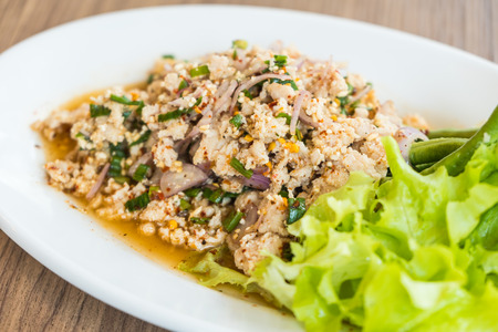 Spicy minced chicken salad in white plate Stock Photo