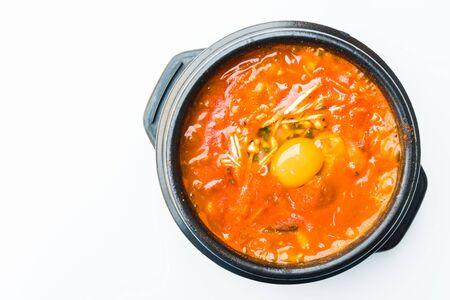 carot: Korea spicy soup in black bowl