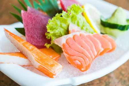 Raw and fresh sashimi dish with salmon , tuna and crab stick - Japanese food style