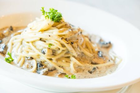 Selective focus point on Spaghetti cream sauce with truffle mushroom in white plate - Italian food stlye