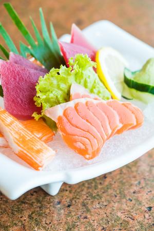 Raw and fresh sashimi dish with salmon , tuna and crab stick - Japanese food style