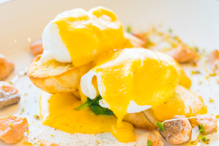 Egg benedict with salmon in white plate for breakfast