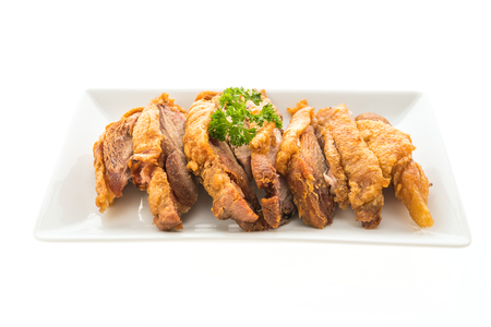 Fried crispy pork isolated on white background - Unhealthy food style