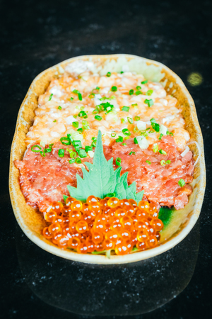 Raw fresh Salmon and Tuna tartar with salmon egg - Japanese food style