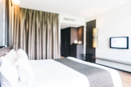 hotel bedroom: Abstract blur and defocused decoration in hotel bedroom interior for background