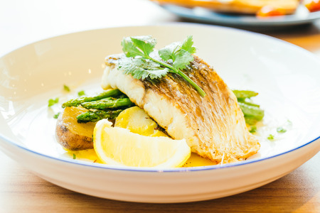 catfish: Grilled Barramundi or pangasius fish and meat steak with vegetable and lemon in plate - Healthy food style