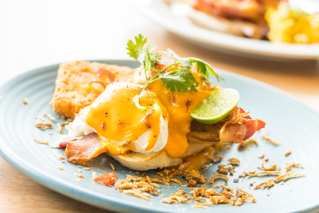 benedict: Egg benedict for breakfast in plate - Selective and soft focus point Stock Photo
