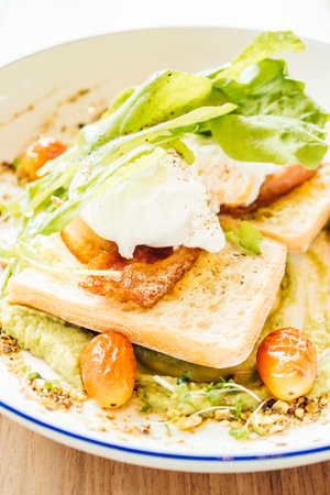 Poached egg with avocado sauce in plate for breakfast
