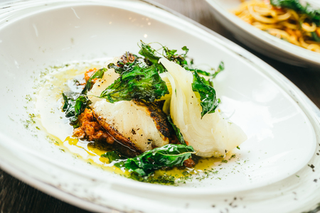 Seabass or Barramundi fish meat steak in white plate - Healthy food style , Color filter Processing