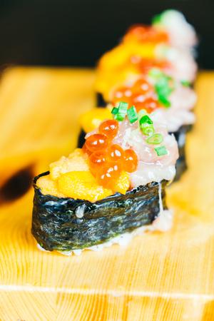 Uni sushi with otoro tuna and salmon egg on top - Japanese food style