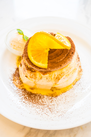 Sweet dessert Ice cream and Pancake with orange on top in white plate Stock Photo