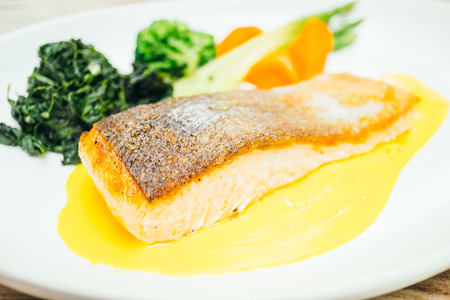 grill: Salmon meat fillet steak  with vegetable in white plate - Healthy food style