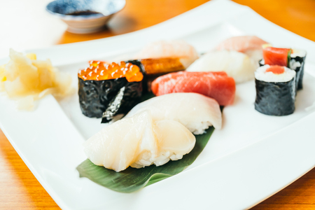 Raw and fresh sushi roll in white plate - Japanese food style , Color filter Processing Stock Photo - 81218300