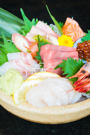 Mixed raw and fresh sashimi with salmon tuna shrimp scallop - Japanese food style