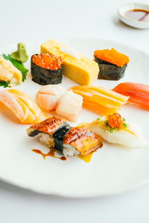 Raw and fresh nigiri sushi set in white plate - Japanese food style , Color filter processing